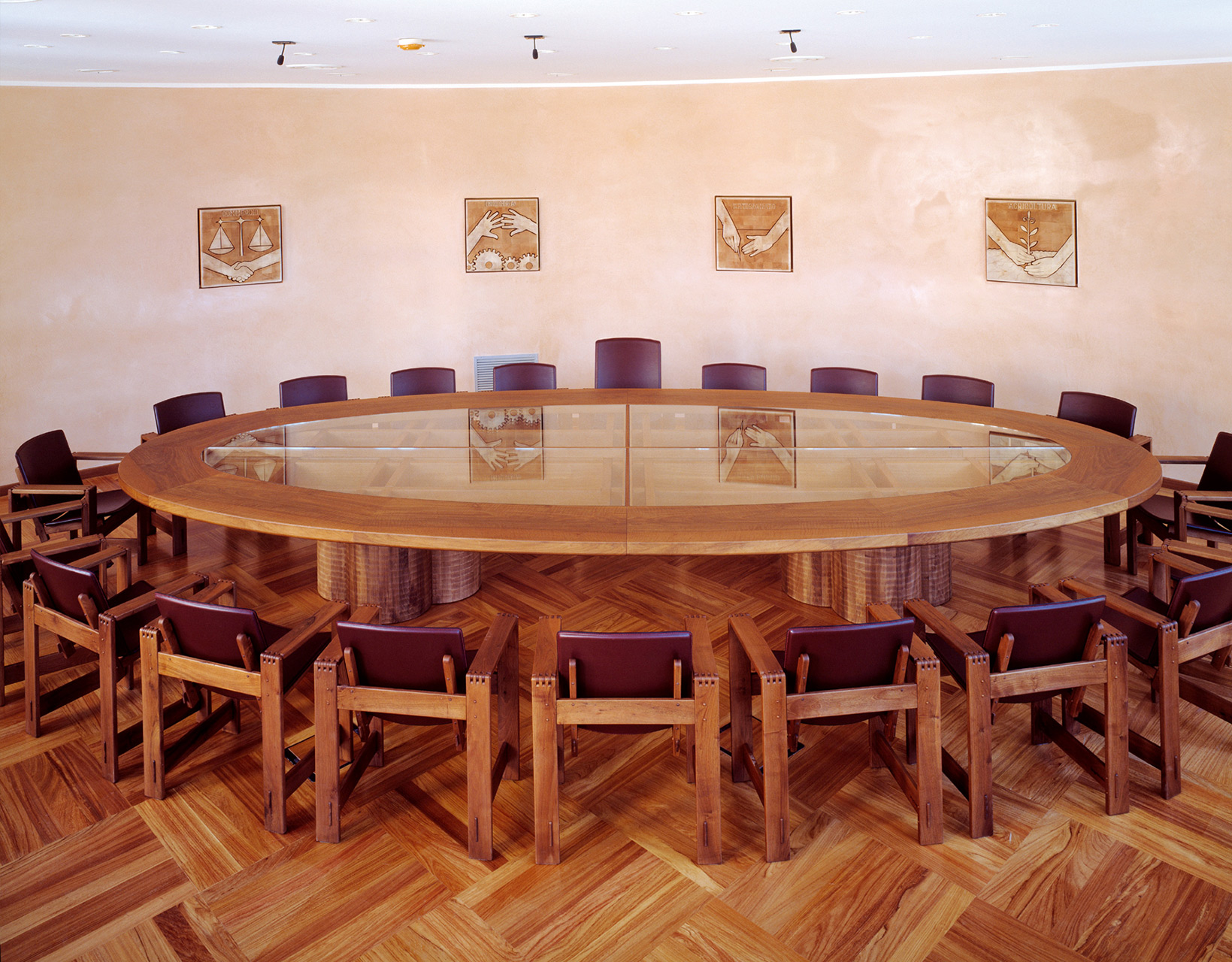 Conference table in Italian walnut with glass top, made to measure. San Marco armchairs in walnut with leather seats.