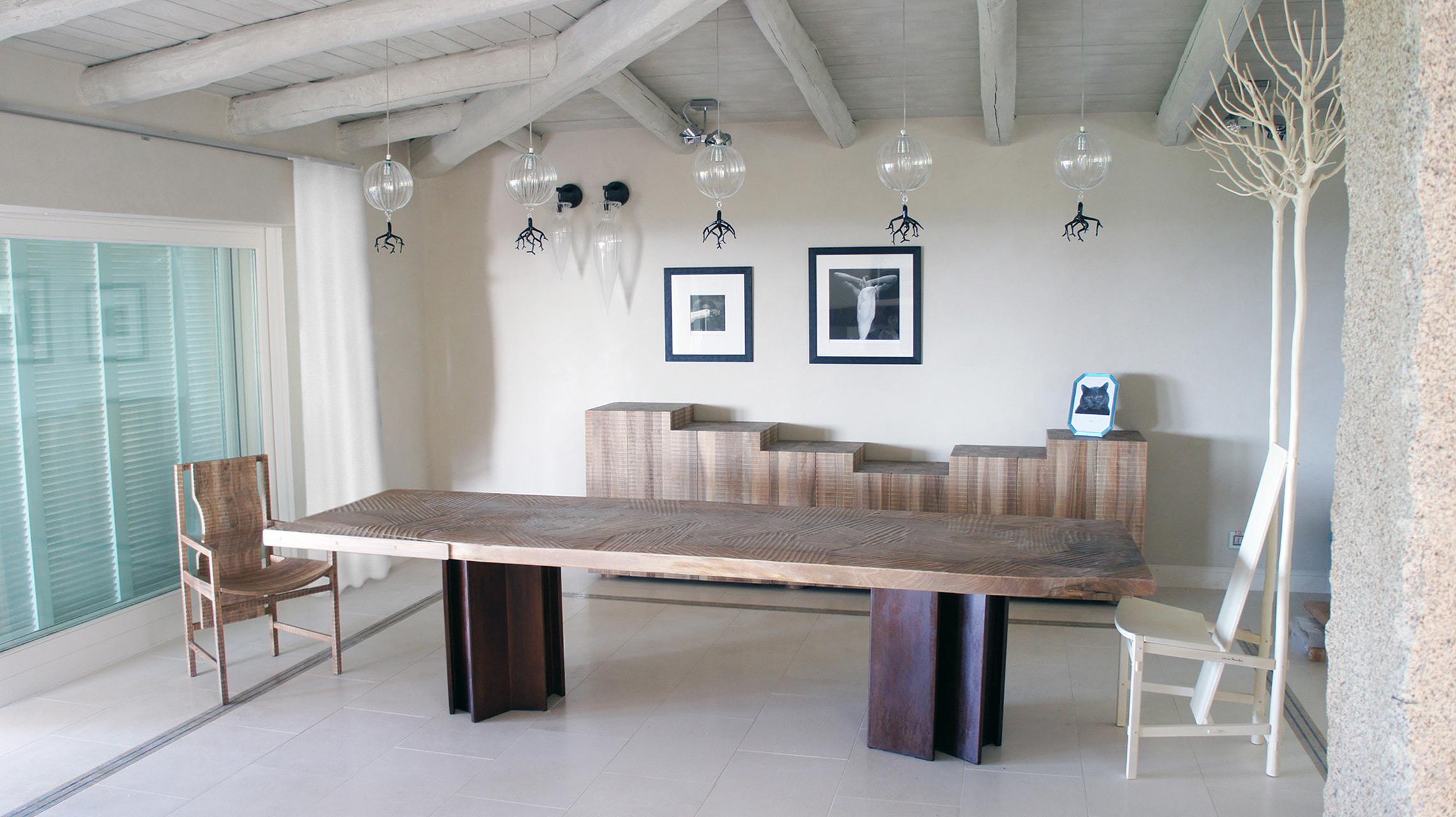 Bespoke table with corten steel legs and Italian walnut top. Nova dresser in Italian walnut Pisana armchair in Italian walnut. Fiorita chair in maple.