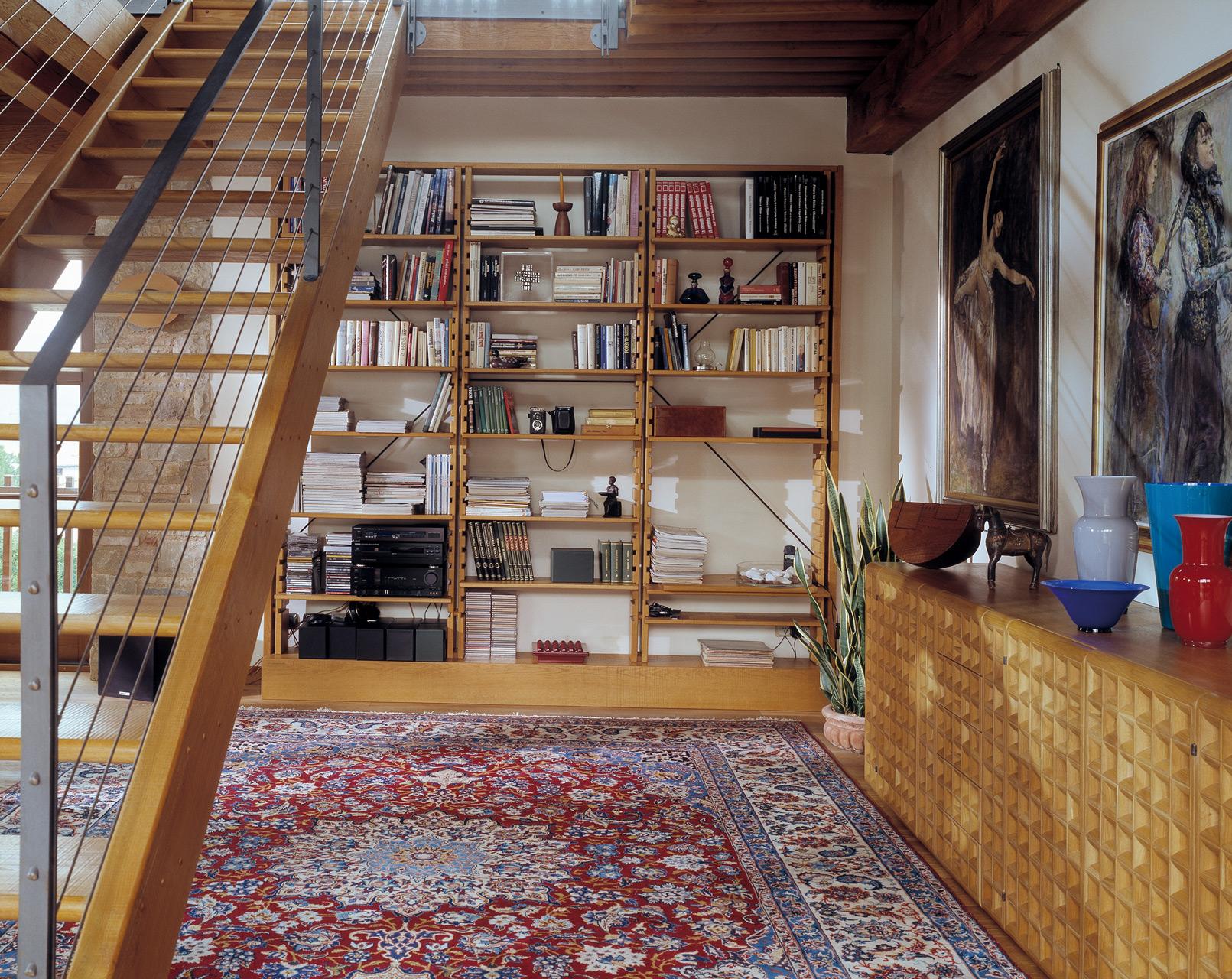 Chiaravalle bookcase in oak. Celata sideboard in oak