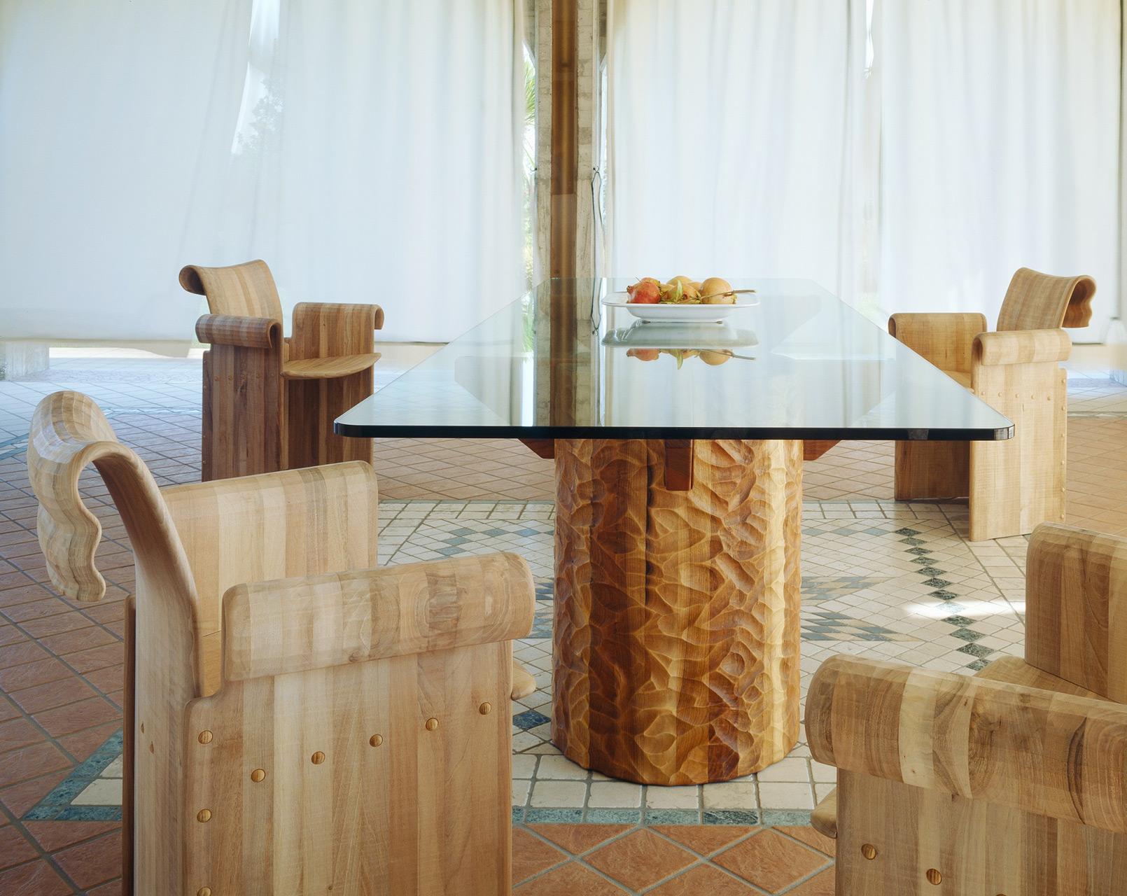 Double coil Velabro armchairs in Italian walnut