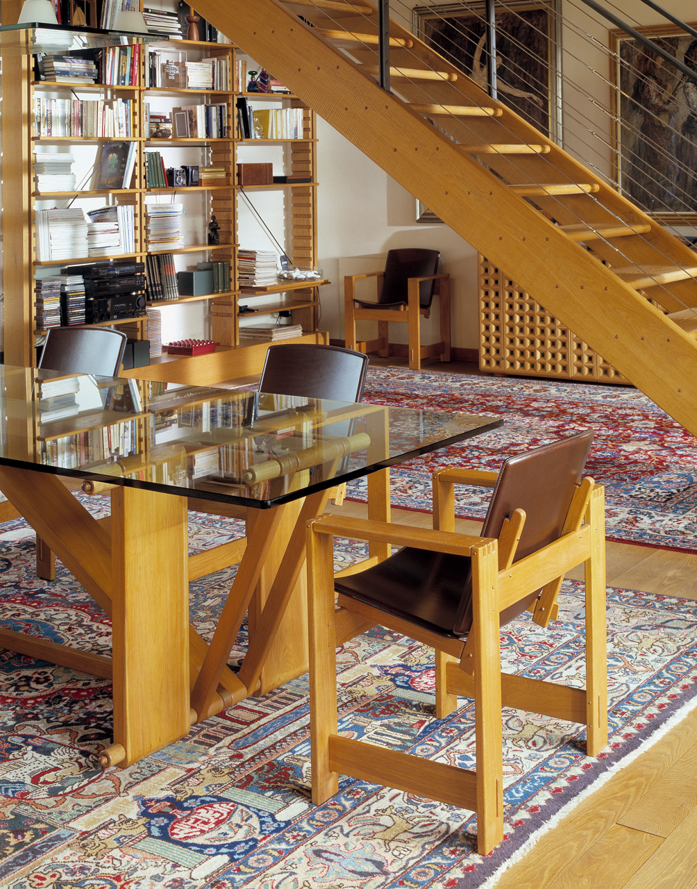 Lombardo table in oak with glass top. San Marco armchairs in oak with leather seats. Bespoke staircase in oak.